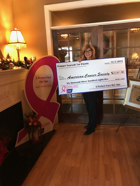 Carol Withers holding check for $6385 for American Cancer Society